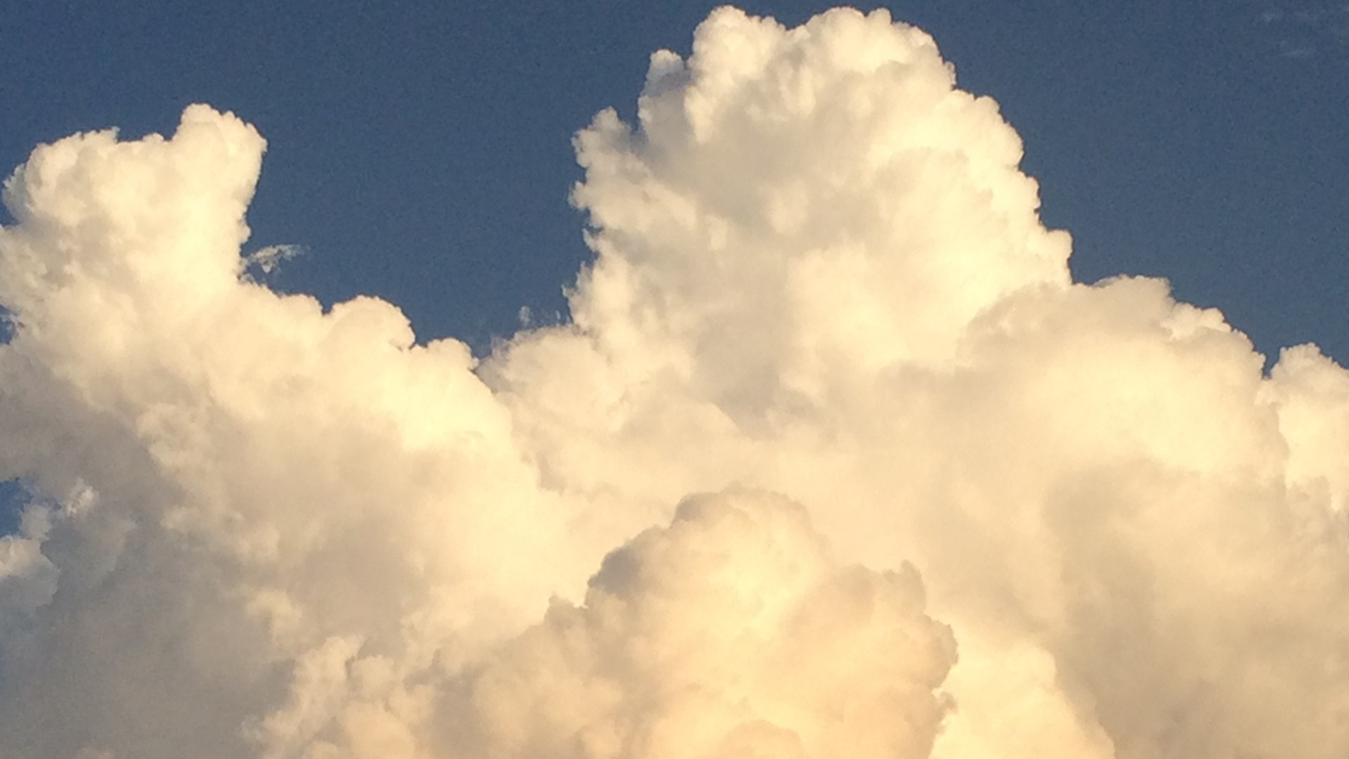cumulus clouds in late afternoon light